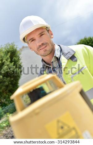 Cheerful site surveyor - stock photo