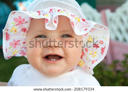 Cheerful smile a little girl in the two teeth - stock photo