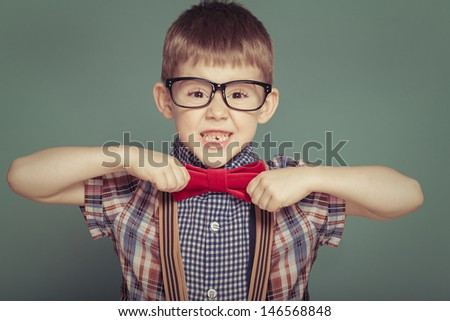 Cheerful smiling boy on a green background. - stock photo