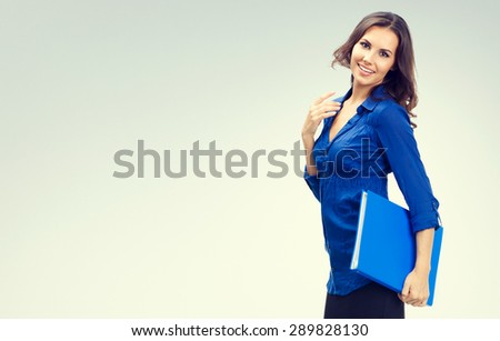 Cheerful smiling businesswoman with blue folder, with blank copyspace area for slogan or text - stock photo