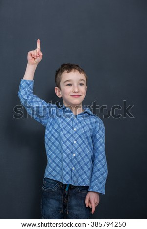 Cheerful smiling child at the blackboard  - stock photo