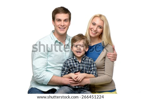 Cheerful smiling family of three enjoying time together. Isolated on white background. Concept for happy family - stock photo