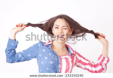 Cheerful smiling girl with unruly brown hair - stock photo