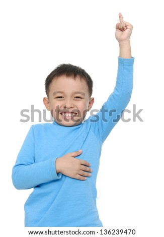 cheerful smiling little boy raised his hands up. - stock photo