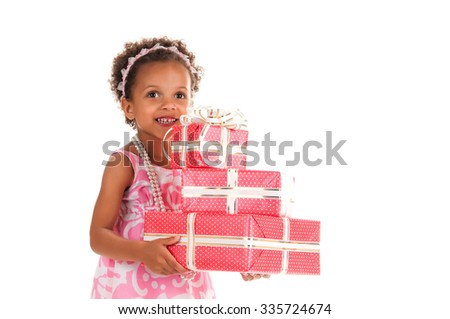 Cheerful  smiling mulatto girl give gift boxes in hands on a white background. Birthday present