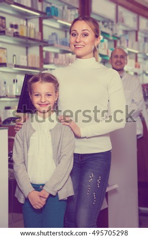 cheerful smiling pharmacist  helping customers with products