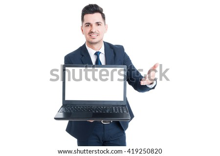 Cheerful smiling salesman showing laptop with blank screen and copyspace isolated on white background - stock photo