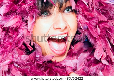 cheerful smiling woman in pink feather portrait, studio shot - stock photo