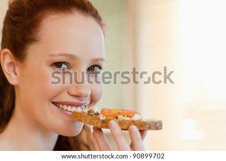 Cheerful smiling woman with slice of bread - stock photo