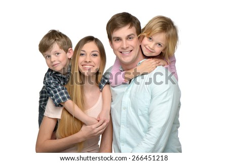 Cheerful smiling young family of four. Children riding piggyback on parents. Isolated on white background. Concept for happy family - stock photo