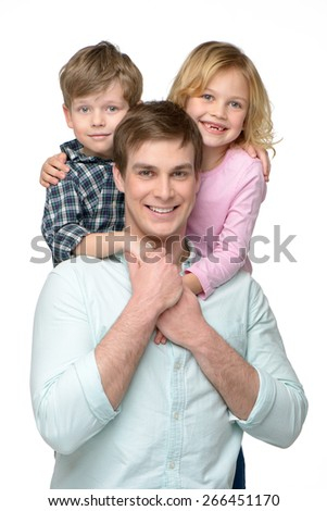Cheerful smiling young father with his two kids. Children riding piggyback on him. Isolated on white background. Concept for happy family - stock photo