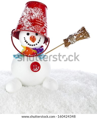 Cheerful snowman with red color bucket on his head  and broom in hand isolated on white background - stock photo