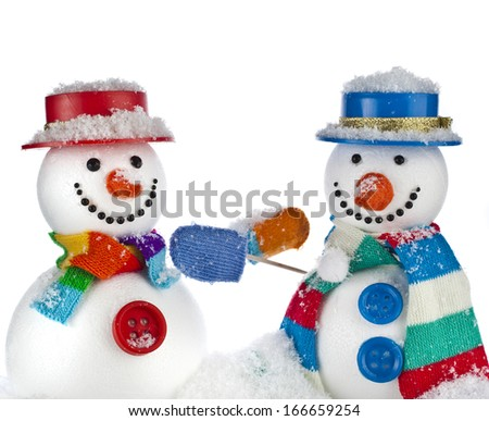 Cheerful snowmans in a striped scarfs, mittens and cylinder hat isolated on white background