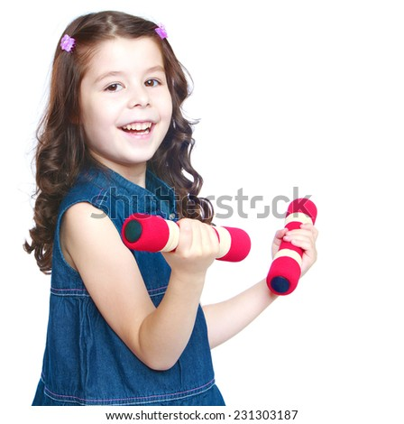 Cheerful sporty girl holding dumbbell. Isolated on white background .
