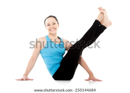 Cheerful sporty yogi girl doing fitness exercises for abdomen, hips, spine, sitting in yoga asana, lifting legs up, isolated on white background - stock photo