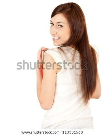 cheerful student girl looking at camera, white background - stock photo