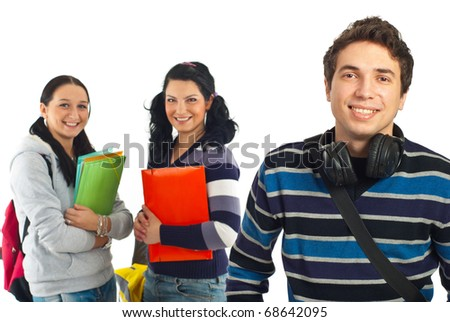 Cheerful student guy with headphones posing near his team of colleagues girls isolated on white background