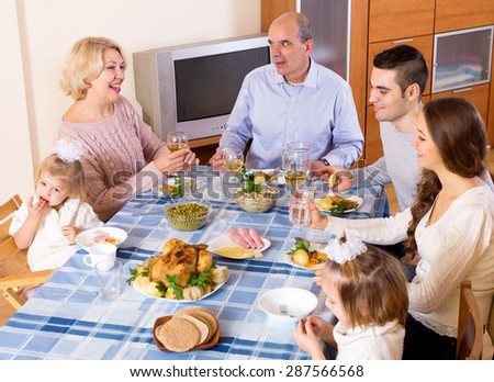 Cheerful sunday dinner in the bosom of family indoor