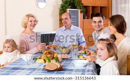 Cheerful sunday dinner in the bosom of happy family indoor
