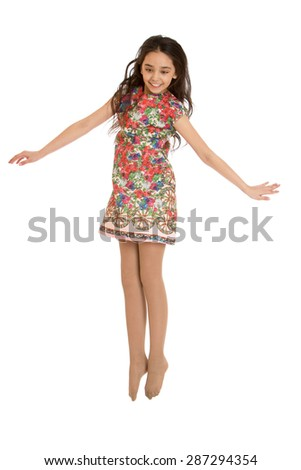 Cheerful teen girl in short summer dress jumping-Isolated on white background - stock photo