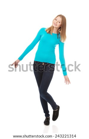 Cheerful teen woman with toothy smile - stock photo