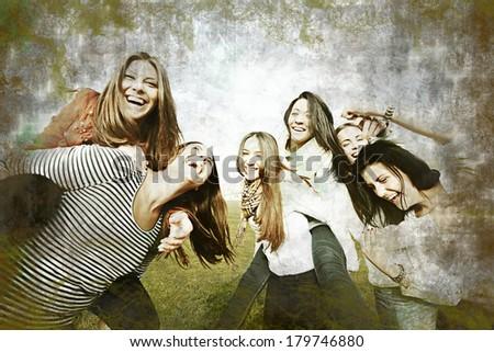 Cheerful teenage girls having good fun time outdoors in retro style - stock photo