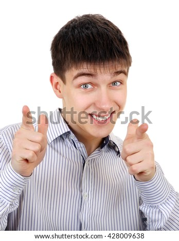 Cheerful Teenager pointing at You on the White Background - stock photo