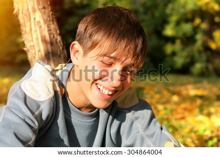 Cheerful Teenager Portrait in the Autumn Park - stock photo