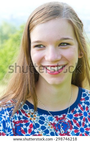 Cheerful teenager with braces - stock photo