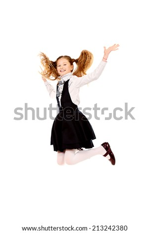 Cheerful ten years girl jumping for joy. Isolated over white. - stock photo
