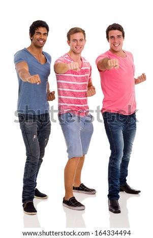 cheerful three friends posing over white background - stock photo