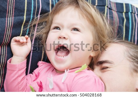 cheerful toddler and daddy having fun laughing very emotional