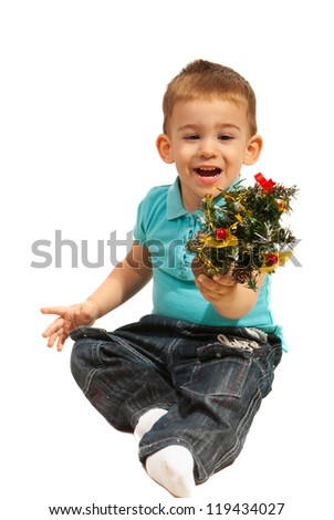 Cheerful toddler boy holding tiny Christmas tree isolated onwhite background