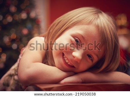 Cheerful toddler girl looking at camera vintage style - stock photo