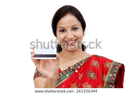 Cheerful traditional Indian woman holding a credit card - stock photo