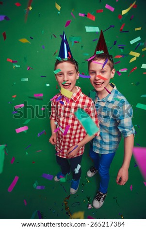 Cheerful twins celebrating their birthday - stock photo