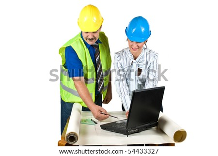 Cheerful two architects in office working on projects and laptop and the man showing her colleague woman something on plans   pointing with pencil isolated on white background