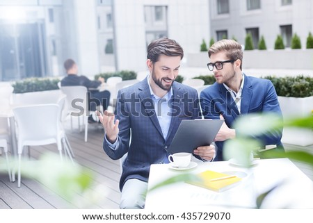 Cheerful two men have a business deal - stock photo