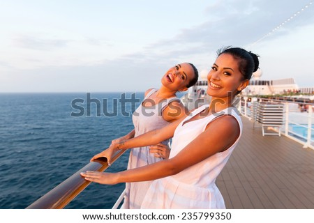 cheerful two women having fun on cruise ship - stock photo