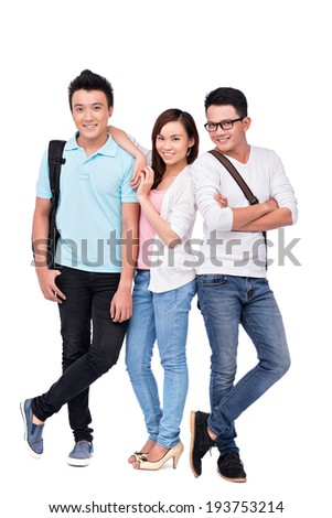 Cheerful Vietnamese pupils standing together - stock photo