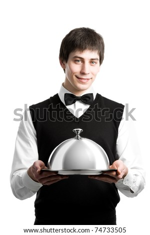Cheerful waiter with metal cloche lid cover - stock photo