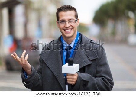 cheerful weather reporter in live broadcast - stock photo