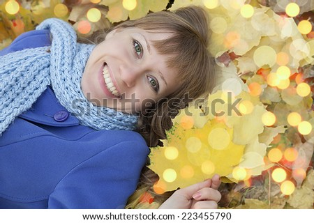 Cheerful woman at autumn fall leaves - stock photo