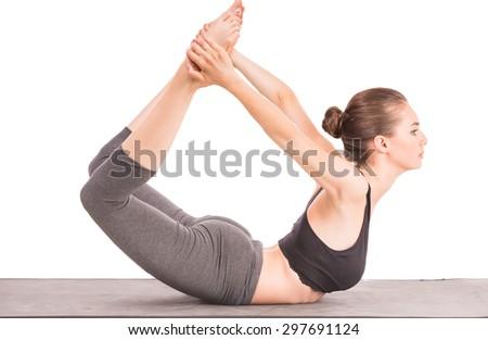 Cheerful woman doing yoga exercise at studio. - stock photo