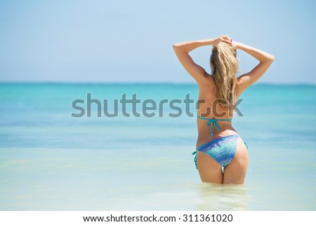 Cheerful woman enjoying vacation in tropical destination