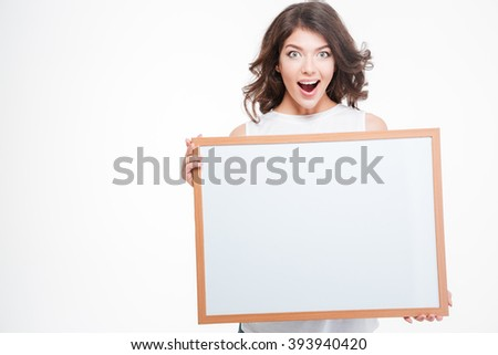 Cheerful woman holding blank board isolated on a white background - stock photo