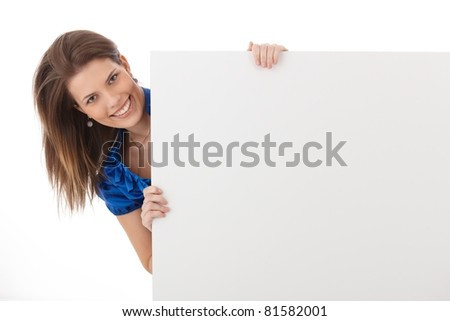 Cheerful woman in studio holding blank sheet, smiling, copyspace.?