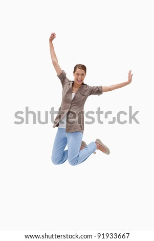 Cheerful woman jumping against a white background - stock photo