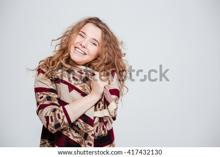 Cheerful woman looking at camera isolated on a white background - stock photo