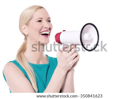 Cheerful woman making announcement with loudhailer